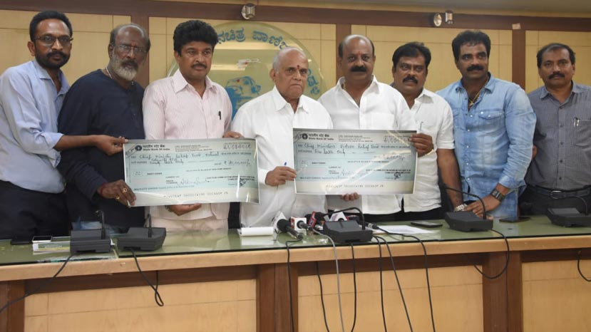kfcc hands over flood relief cheque